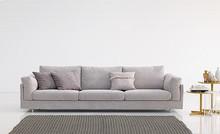 Sofa ZENO to mebel o unikatowym designie. Posiada ona łagodne kształty i miękkie wypełnienie. Jej poduszki siedziskowe posiadają wsad z pianek...