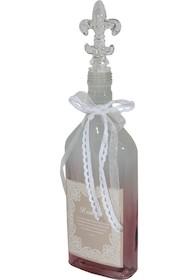 Bardzo efektowna szklana butelka dekoracyjna z ozdobnym korkiem to ciekawa ozdoba, która świetnie zaprezentuje się na półce w jadalni, salonie i kuchni.