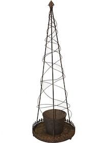Niebywale dekoracyjny kwietnik w kształcie stożka, wykonany z metalu w kolorze starego mosiądzu. Na okrągłej podstawce usytuowano osłonkę na kwiaty....