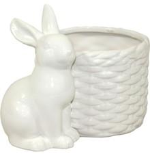 Ceramiczna wielkanocna doniczka. Biała osłonka w połysku idealna na świąteczne, wiosenne kwiatki w towarzystwie siedzącego Zajączka. Idealna ozdoba...