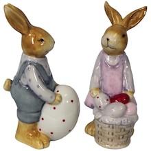 Ceramiczne figurkizajączków w ludzkich strojach z pisankami. Figurki to idealna ozdoba wielkanocnego stołu czy stroika. Szczegółowe wykonanie i...
