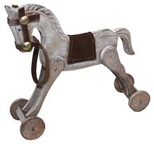 Kolekcja drewnianych figurek przedstawiających konie na biegunach lub kółkach. Dekoracja, która przypominać ma o dzieciństwie i niewinnych czasach, o...