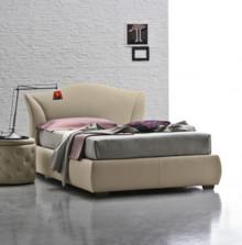 MADDALENA to niezwykle stylowe, eleganckie łóżko tapicerowane od Target Point. MADDALENA posiada elegancki, sinusoidowy kształt, który nadaje charakteru...