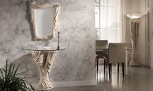 CATULLO to konsola pochodząca z kolekcji Klasycznej od Target Roso.<br />Konsola wykonana z ceramiki, bogato zdobiona. Rzeźba, która z niej...