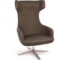 Fotel posiada metalową strukturę. Siedzisko wraz z wysokim oparciem tapicerowane jest ekoskórą z ozdobnym szwem.<br />Produkt do...
