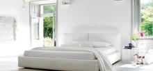 Tapicerowane łóżko cleo do sypialni